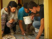 Amra, Andrea and Gergő working on the mozaic using left-over tiles